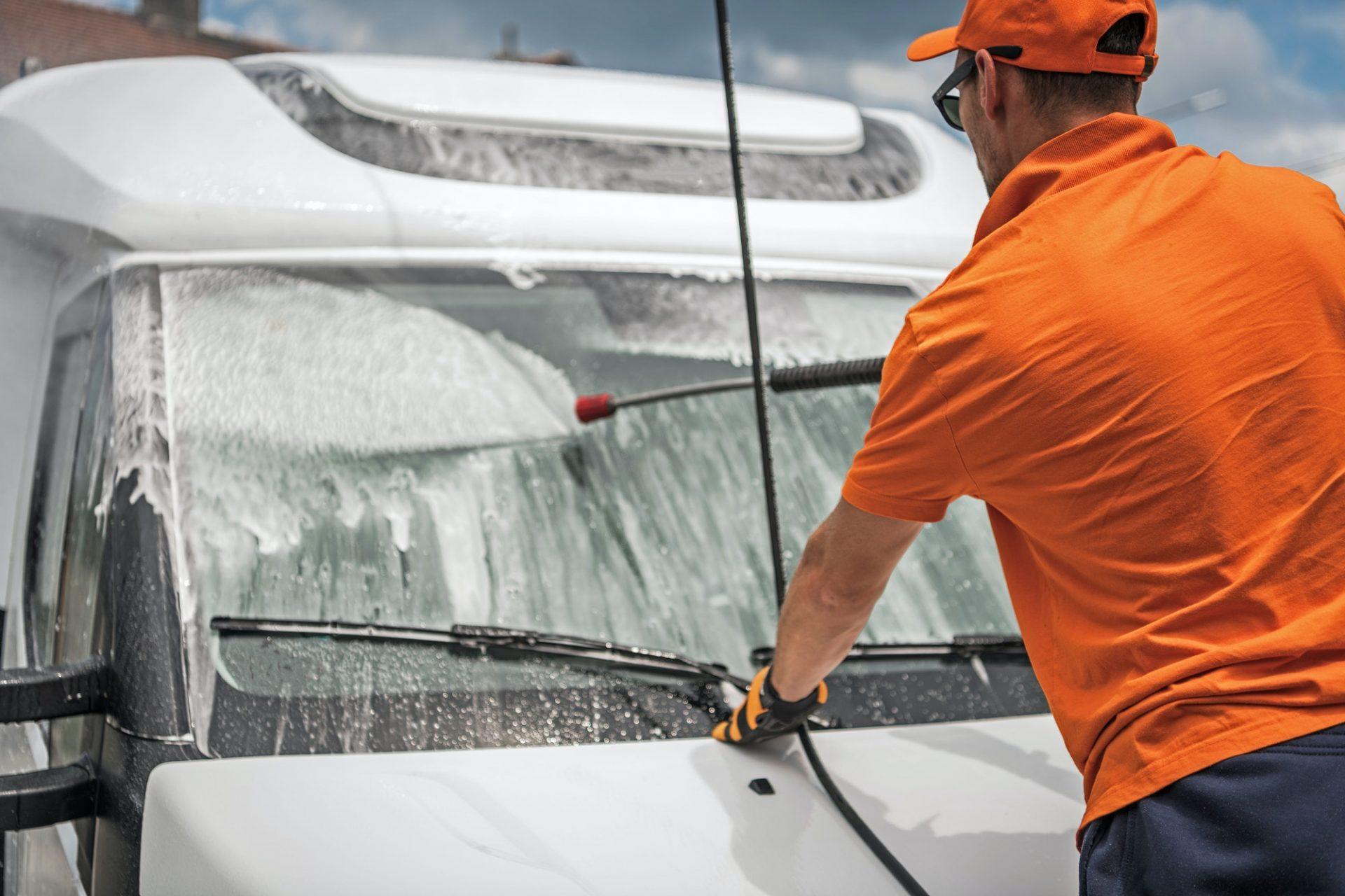Men Pressure Washing His Truck Windshield